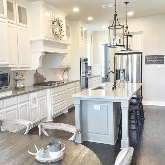 White farmhouse kitchen with soft grey island. Like two different colors of granite tops.