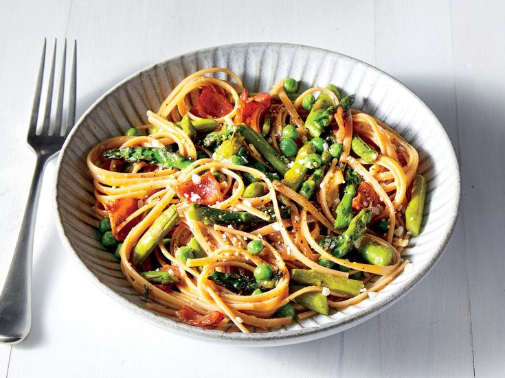 Fresh asparagus and peas lend a bright spring flavor to the classic bacon, egg yolk, and Parmesan carbonara sauce. To get just the right ...