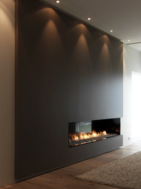 dark coffee bean feature wall, contemporary fireplace and gorgeous rich wood floor - cheminee