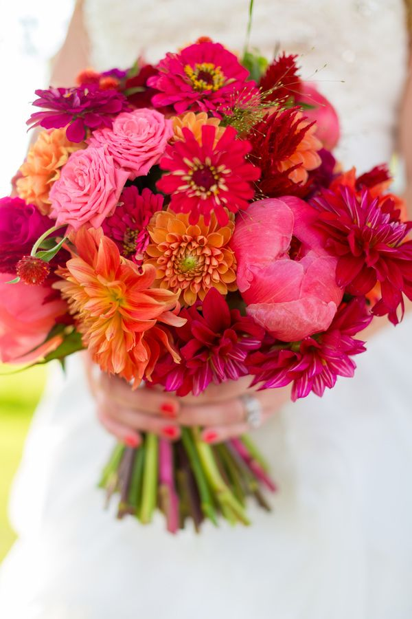 pink and red bouquet with dahlias, peonies, and zinnias, photo by Tami Melissa Photography http://ruffledblog.com/fiesta-on-the-farm-wedding #bouquets #flowers