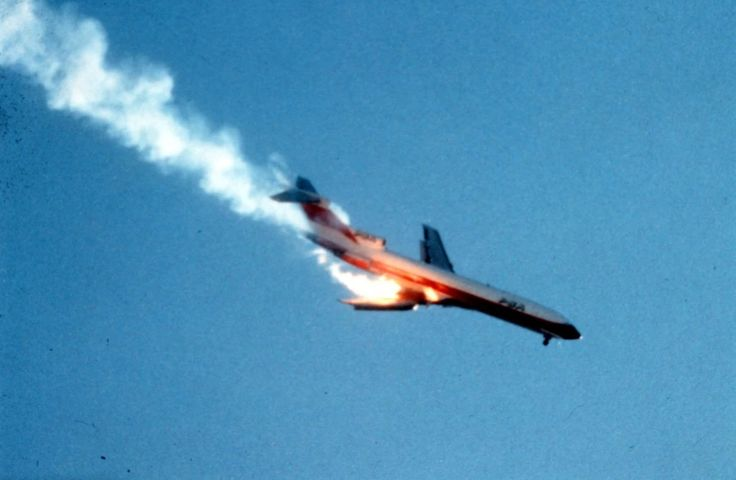 A Pacific Southwest Airlines Boeing 727 burns after crashing into a small private airplane, before crashing seconds later into a crowded San Diego housing development, September 25, 1978. All 137...