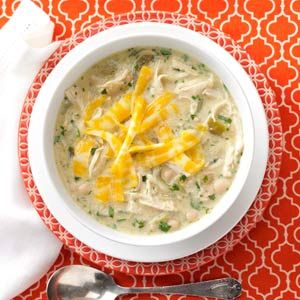 Green Chile Chicken Chili Recipe -The prep work for this chili is easy thanks to several pantry staples. It's loaded with shredded chicken and beans. The spicy heat can be tamed a bit by cool sour cream. —Fred Lockwood, Plano, Texas