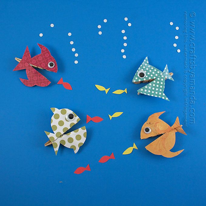 Make a colorful school of adorable fish using wooden clothespins and scrapbook paper! A fun craft for the kids.