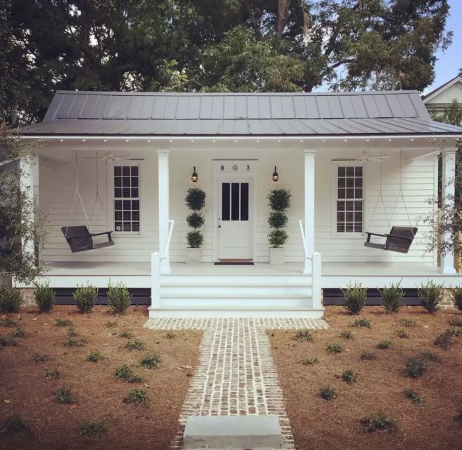 If ever a cottage had a picture-perfect porch, it's this sweet stunner. The inside is too cute!