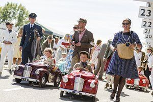 Children take part in a vintage pedal car race during the Goodwood Revival at…