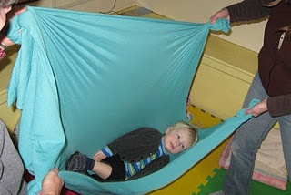 sensory activities--we now swing the kids to bed every night.  They absolutely love it!