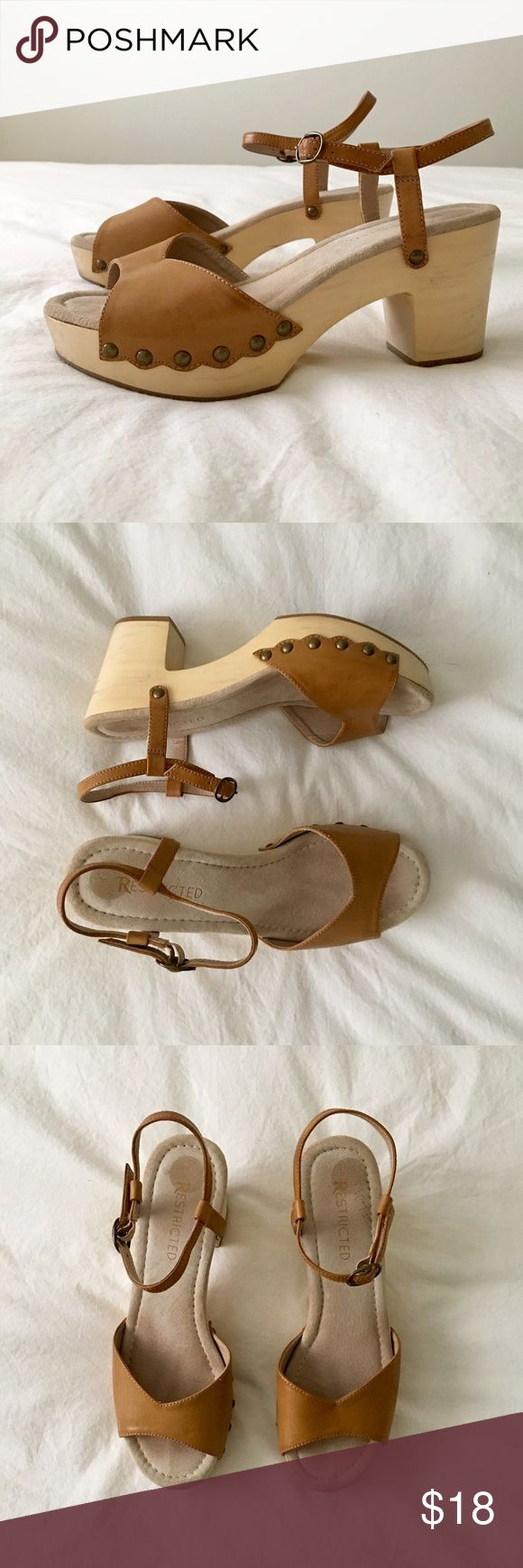 Restricted Clogs Super cute clogs! Vintage vibes. Look great with dresses and jeans. Tan color with wooden heel. Some scuffs on the heals and toes (pictured). Size 8. Restricted Shoes Mules & Clogs