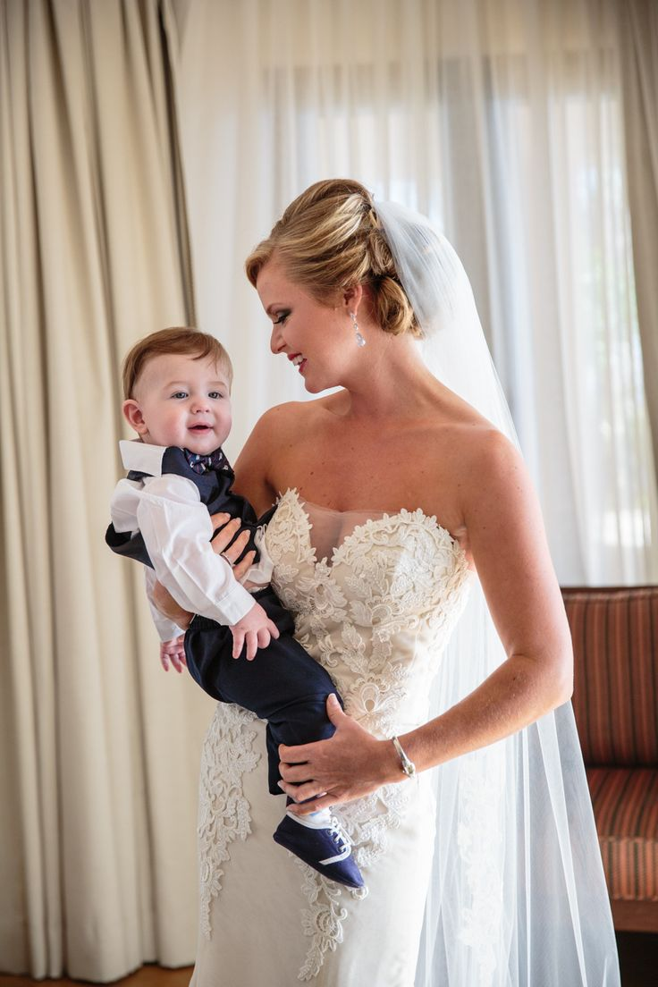 Mommy bride and the cutest bestman in the world. Wedding gown by Ines di Santo. Destination wedding at Esperanza Auberge Resort in Cabo San Lucas, Mexico. Photography by Anna Gomes Photo.