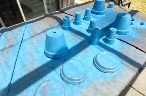 Spray painting the Terra Cotta pots for the Disney Frozen Centerpiece