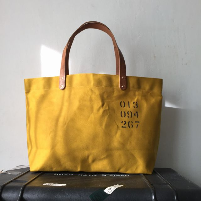 """Tote bag with wax canvas. I have stenciled """"013 094 267″  IND_BNP_0267 W 46cm H 27cm D12cm Handle 46cm"""