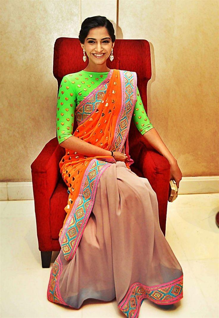 Sonam Kapoor in a bright color blocked sari by Manish Arora