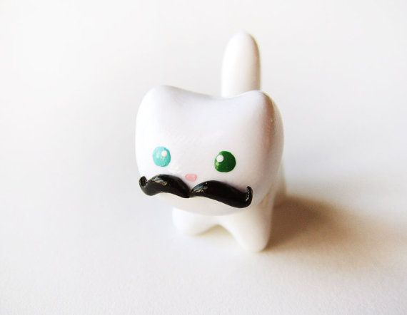 Funny Black Mustache White Cat Charm by MadAristocrat on Etsy.    Mustaches are SO the it thing :)