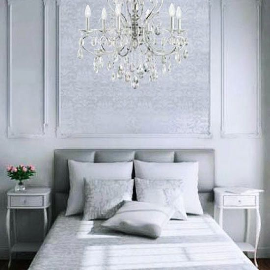 Orderly Approach: If an absence of color soothes you, try taking this bedroom's approach. Awash in a sea of gray, the room creates interest with tone-on-tone fabrics, intricate paneling, and textural contrast between a leather headboard and a glittering chandelier. To replicate the wall treatment above the headboard, simply frame wow wallpaper with picture molding.