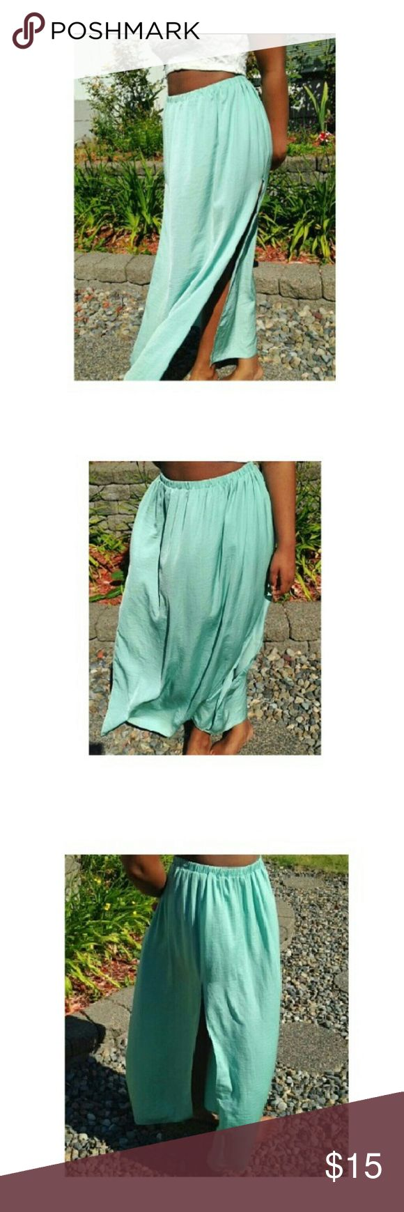 Zara Trafaluc mint green skirt Medium mint green Zara skirt. This skirt is long, it stops about 2 inches from my ankles, and I'm 5'5. It is in great condition, no rips, no tears.     (I do accept trades) Zara Skirts