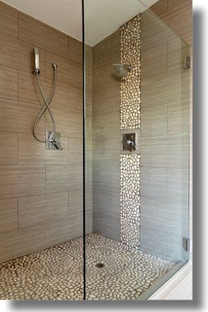 Beautiful pebble floor and wall detail for the shower. Just what we are planning to do in our basement shower!!