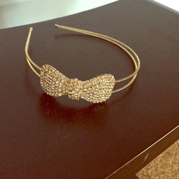 Metal bow headband Metal headband with rhinestone bow. Other