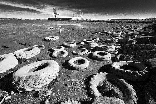 """Tires Dumped at Tire Beach aka Toxic Beach or Kafka Beach. Pollution (San Francisco). Looks much better in large size. This nice beach belongs to San Francisco's """"Warm Water Cove Park"""" (see exact location on google maps). Here, the bay water is warm because it comes off the steam turbines of the nearby Potrero Power Plant (currently not operating, though, because its air pollution levels are above the authorized limits). Apparently for years this beach has been used as an illegal t..."""