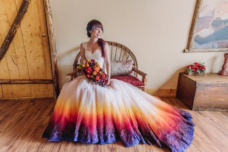 "More and more brides are starting to make the bottom of their wedding dresses the place to showcase their ""something blue."" And it's not just blue. We're seeing more wedding dresses featuring a dip-dyed effect at the bottom in every color imaginable, and the trend is truly more beautiful than"