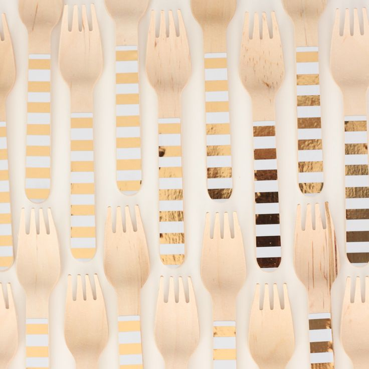 Stunning gold foil wooden forks.  They come in a pack of 24 and are also available in gold polkadot.  Available here http://www.hipandhooray.com.au/gold-foil-stripe-wooden-forks-24pk