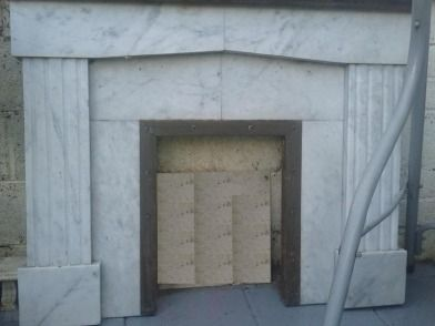 Marble Fireplace - White and grey Marble fireplace. Brass studded fire surround. Only needs a poli...