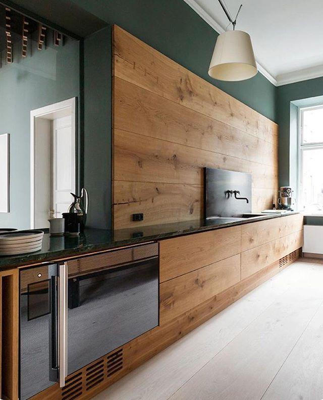 Wide Hart Oak panelling & flooring in this Dinesen showroom kitchen