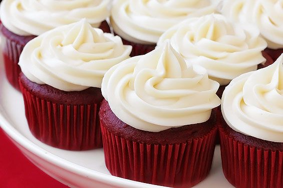 "Red Velvet Cupcakes with Cream Cheese Frosting. ""I just made this recipe last night and I can say that it is the best red velvet recipe I've used. The cake was very moist and dense. They turned out fantastic!"""