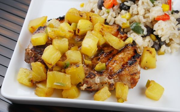 Chili-Rubbed Pork Chops with Grilled Pineapple Salsa. Served with a flavorful pineapple salsa on top, these pork chops will be a hit with the whole family.