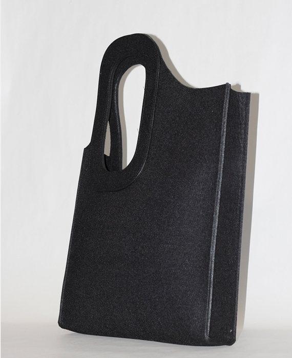 Black felt bag with asymmetrical handle