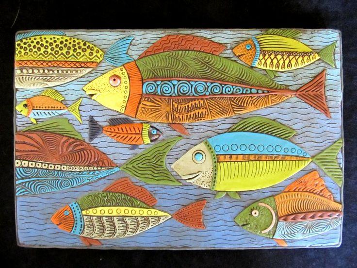 Fish, polymer clay wall hanging, Karen Brueggemann, using several Helen Breil stamp designs.
