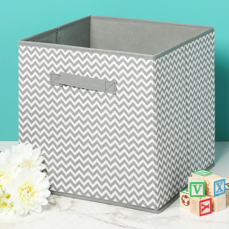 "Whatever you're storing, it's gonna like its swanky new digs. Limit 3 Happy Hour Items Per Order Collapsible storage cube Great for storing toys, remotes, controllers, art supplies, and more Folds compact and stores when not in use Bottom insert for stability Attached handles for easy carrying Chevron pattern Measures 12.25"" W x 12.25"" H x 12.25"" L By Just the Nest Imported"