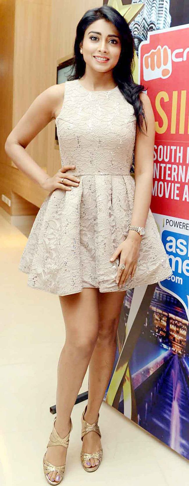 Shriya Saran at a press meet in a lace full-skirted dress. #Style #Bollywood #Fashion #Beauty