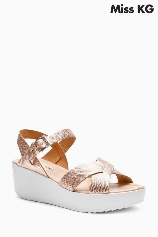 Have a rose gold obsession? Us too! Add to your collection with these Miss KG wedge sandals!