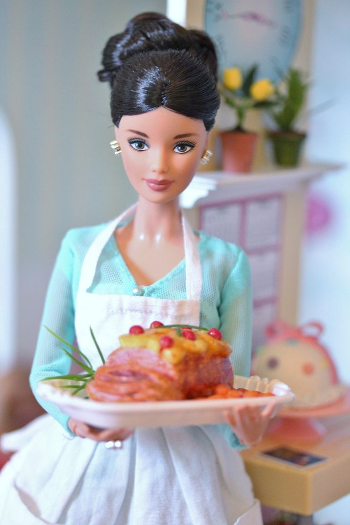 Barbie can bring home the bacon and fry it up in a pan!