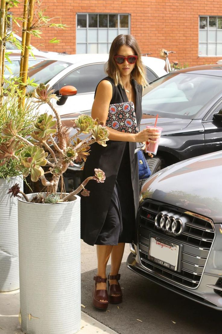 Jessica Alba wearing Chanel Reissue 2.55 Bag and Chanel Clutch