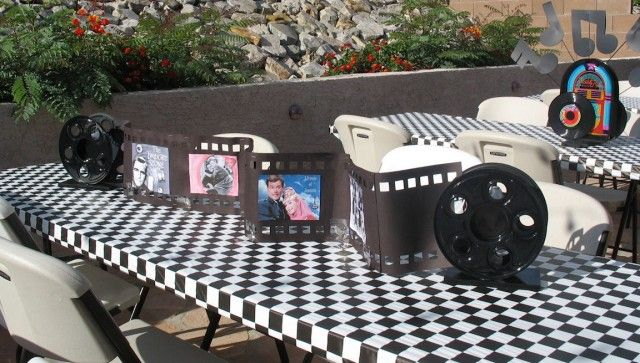50's Themed party - love the idea of pics of old TV shows for a centerpiece