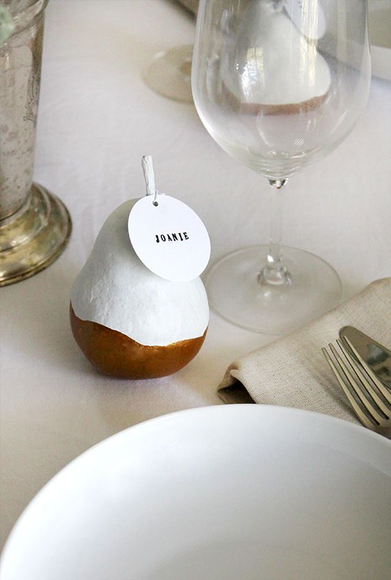 DIY Pear Place Cards: While these sweet fruits are often used in fall recipes, these copper and white color blocked pears make the perfect seasonal decorations for a Thanksgiving table. Use fake fruits to reuse this DIY idea for holidays to follow. | 10 DIY Escort Cards for Your Holiday Events and Weddings