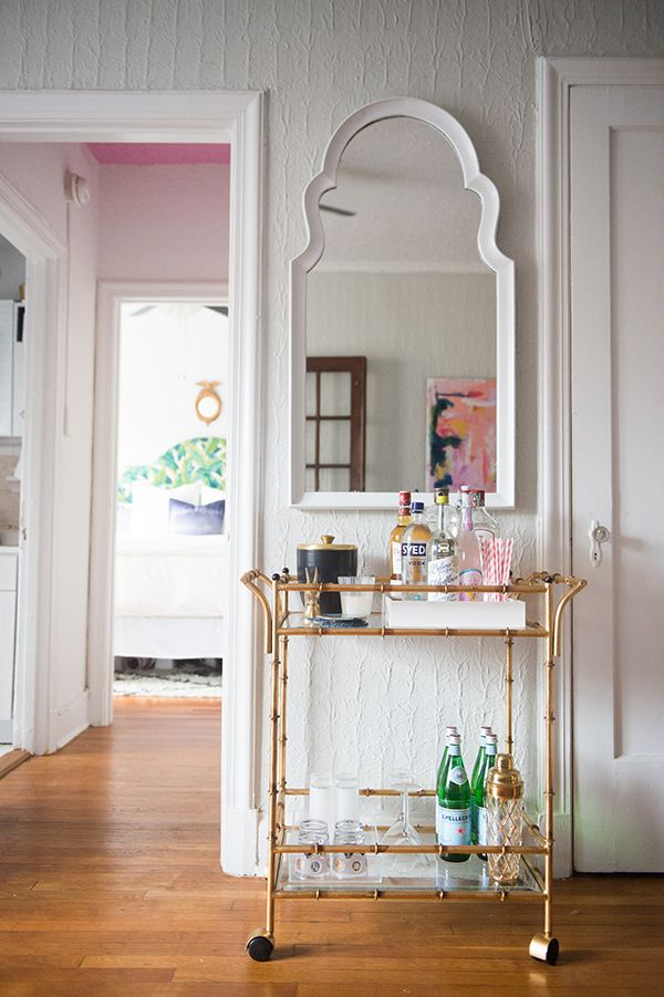 Gold bar cart styling. Plus we spy a  pink ceiling. #glitterguide