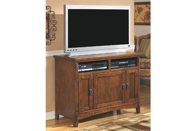 A big hit with fans of Arts and Crafts and Mission-style design, the Cross Island large TV stand deserves a standing ovation for its form and function. While it certainly charms with details, including replicated mortise-and-tenon corner work and cast hardware in an aged-bronze-tone finish—it's got loads of functionality, including cord management, adjustable shelving and vented media storage.