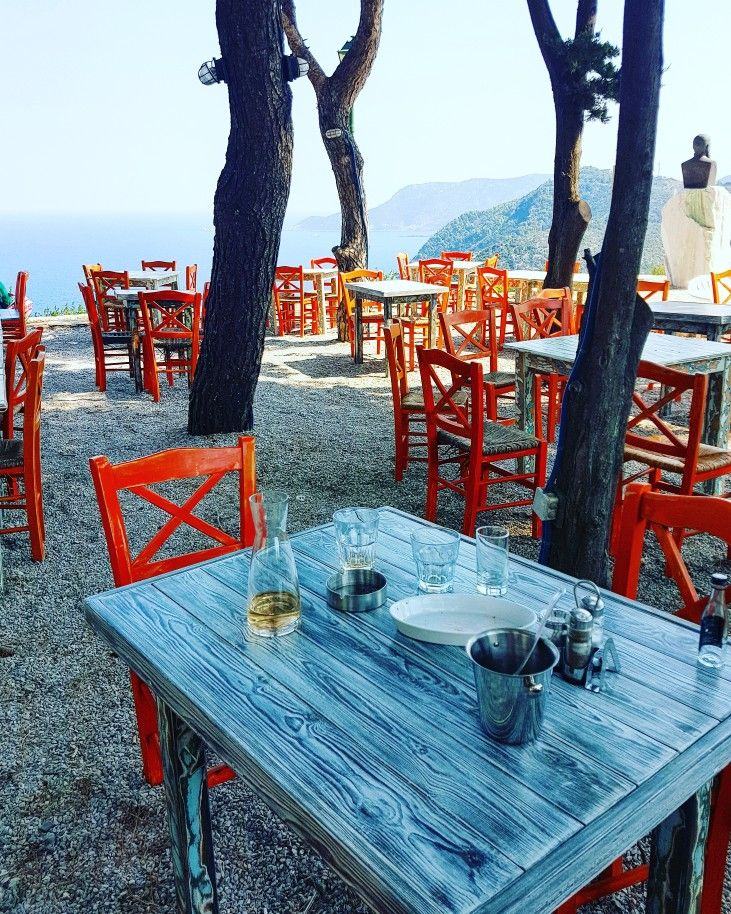 Old Village of Alonissos...autumn... www.angelosalonissos.com #angelos_apartments #alonissos #sporades #greece #autumn #oldvillage #chora #island #instagood #instamood #instalike #alonisos #alonnisos #alonissosisland #table #colors #chairs #orange #pines #september