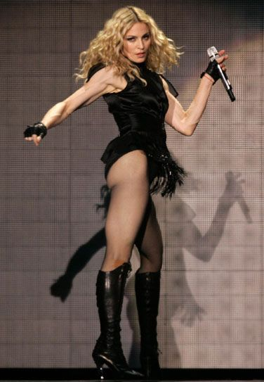 Madonna performs during her Sticky and Sweet tour in London
