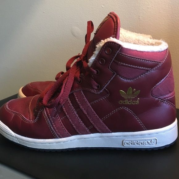 Adidas burgundy and gold high top shoes Size 8.5 men's (fits size 9.5/10 women's). Worn a few times indoors only. Burgundy laces have a couple of snags but comes with an additional pair of blue laces that came with the shoes. Offers welcome. Adidas Shoes Sneakers