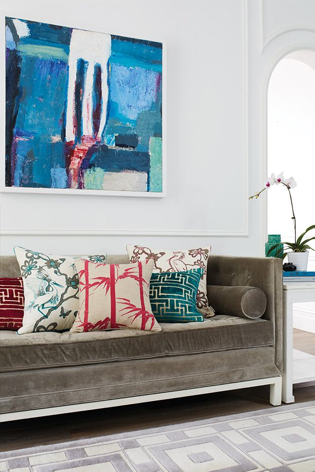 Florences fabric used as cushions on the couch add texture and interest and are a great example of how everything doesn't need to match. The abstract style of the artwork mixed with the traditional fabrics of the cushions is pulled together by using a few colour tones that balance each other out nicely.