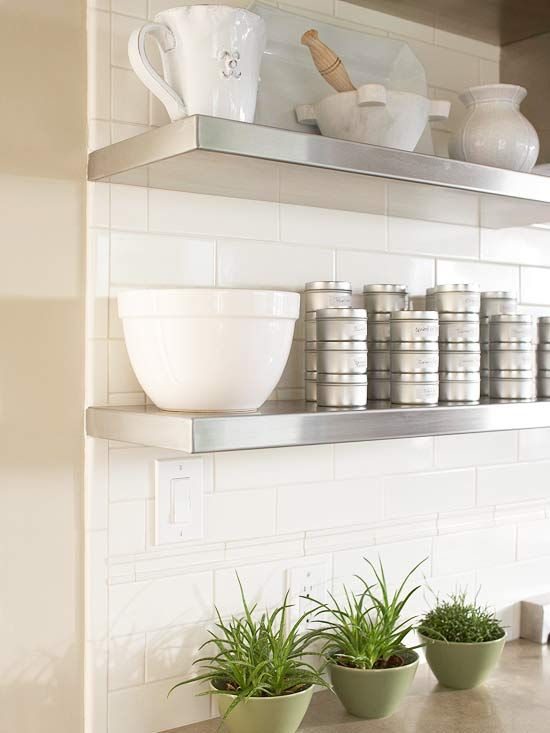 Style & Storage  Contemporary meets classic as stainless-steel shelves pair with subway tiles. Tins keep spices potent, and sturdy shelves store often used cooking tools.