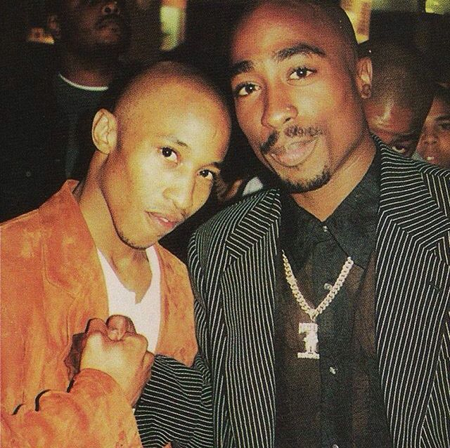 Fredro Starr and Tupac Shakur at the premiere of the 'Sunset Park' movie soundtrack, held at the Magic Johnson Theatre in New York. The photo was taken for The Source magazine, 1996.