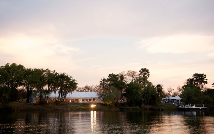 Marquee wedding on the banks of the Zambezi River, Victoria Falls, Zimbabwe. #wedding #grand #marquee #gold #glamour