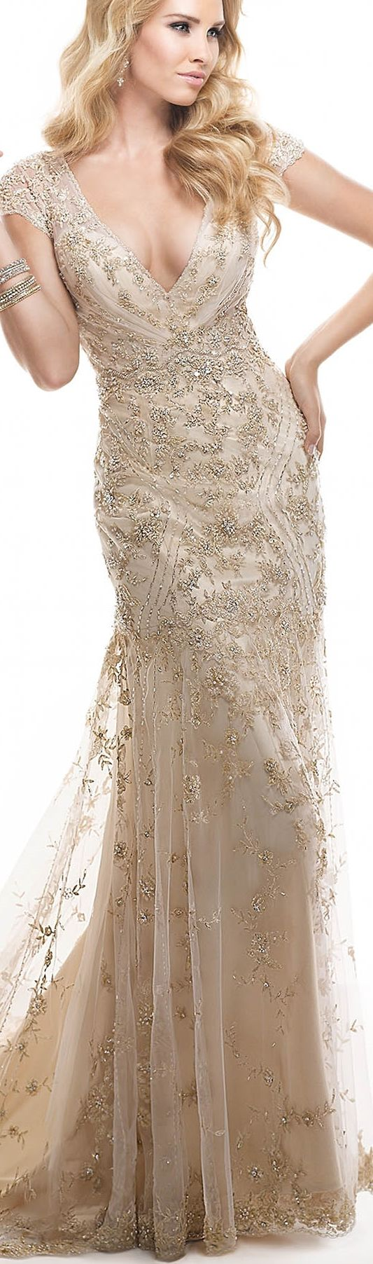 Maggie Sottero | Tuscany | All things feminine are found in this dazzling sheath gown - a dramatic back, delicate cap-sleeves and sparkling lace. Beaded metallic embroidery on tulle features twinkling Swarovski crystals, finished with zipper over inner elastic and crystal button closure. Ivory over Alabaster, Gold over Champagne