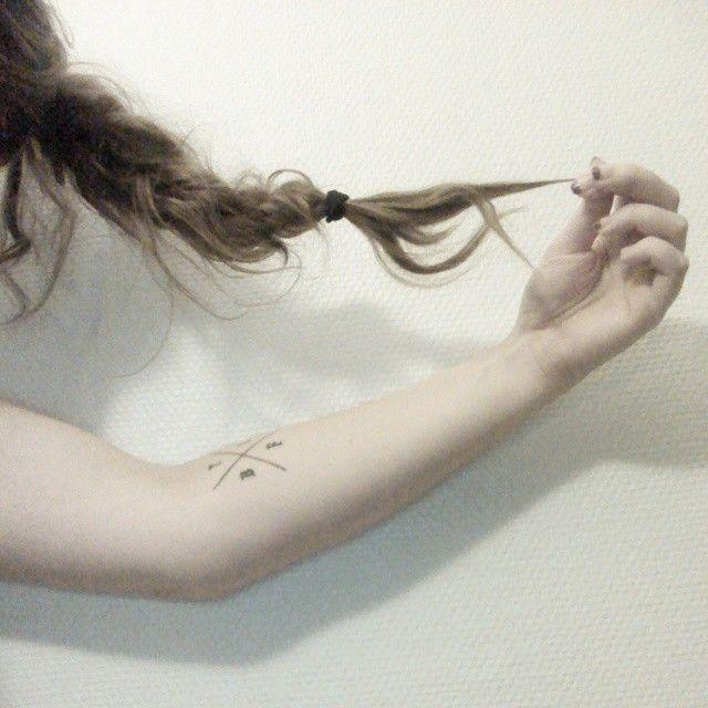 Minimalistic tattoo, messy braid