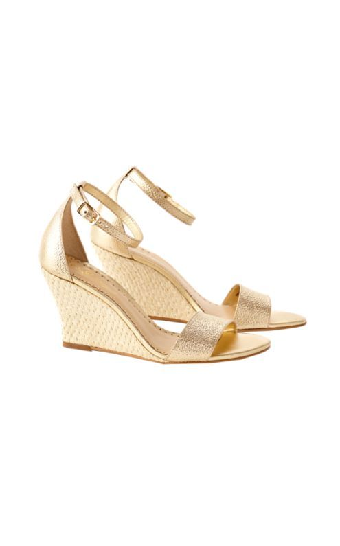 The Bridgette Wedge is a gold wedge perfect with any of your Lilly shifts. This 3 inch wedge has a raffia heel and is made with textured gold caviar leather. You'll find yourself wearing these wedges everywhere this season and beyond.