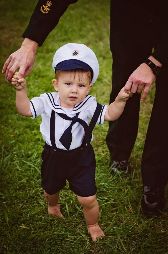 What a cute sailor shorts outfit , with suspender straps, and cute nautical design on the buttons, please look at the pictures; the captain hat is