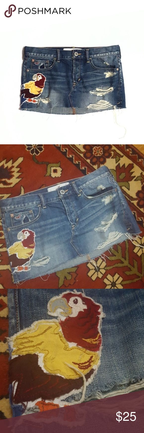 "Hollister Distressed Ripped Denim Short Mini Skirt So cute. 100% cotton. Excellent condition. Company distressed including rips and tears. Cute parrot patch.  Waist approx 16"" across when flat, length 9 3/4"" (front), 12"" (back). Hollister Skirts Mini"